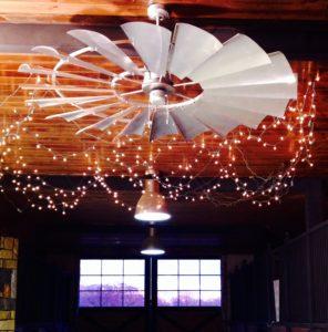 windmill ceiling fan cooling horses in barn