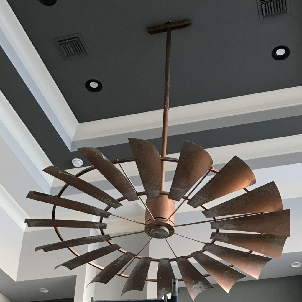 Eight foot patina copper windmill ceiling fan with a gorgeous tone-on-tone vaulted ceiling.