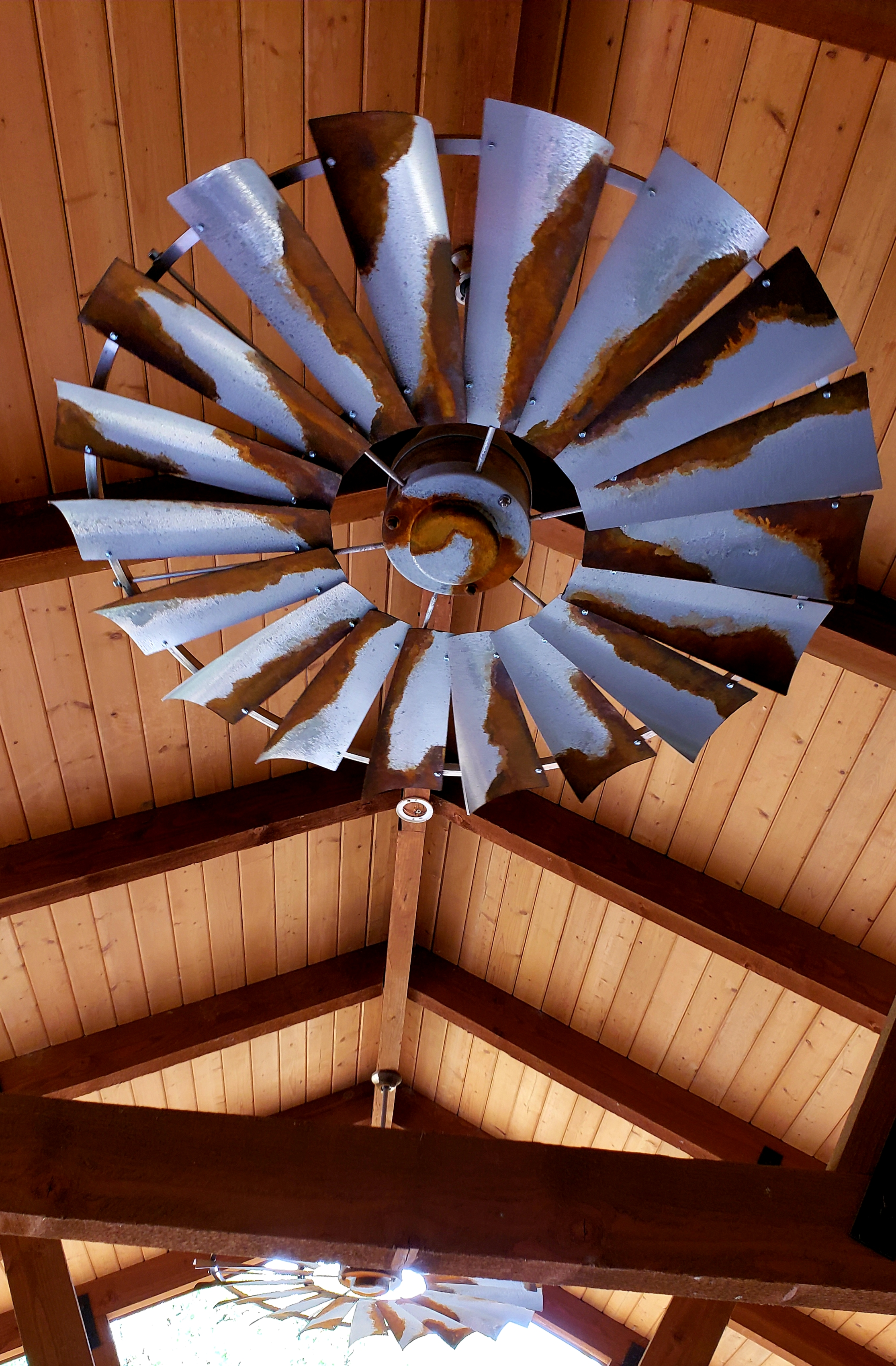 barn metal custom finish on windmill ceiling fan including a wood vaulted ceiling